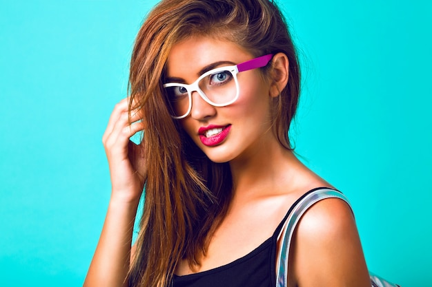 Close up fashion portrait of beautiful woman, hipster vintage sunglasses, bright make up, full lips