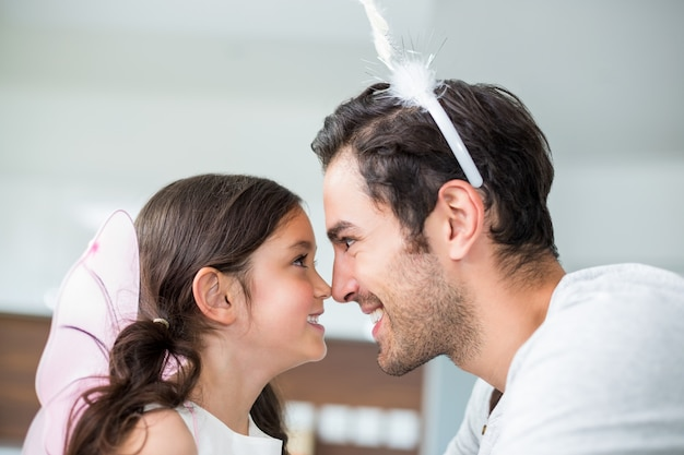Close-up of father and daughter in fairy costume