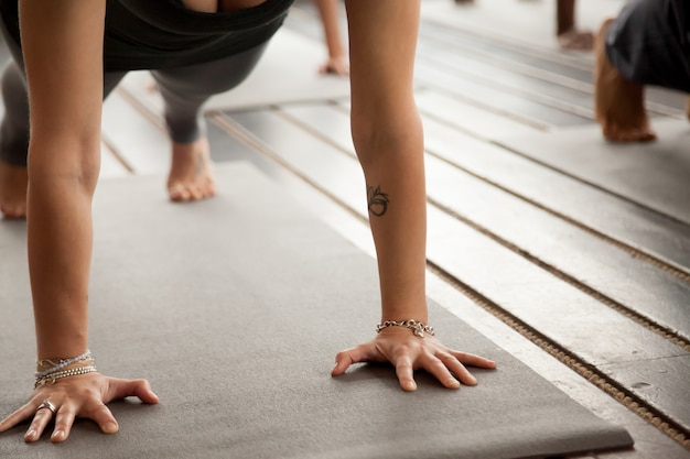 Close up of female arms in plank pose