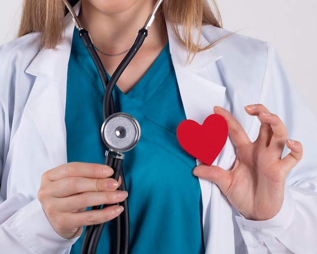 Close-up of a female doctor with a happy red heart, greeting
