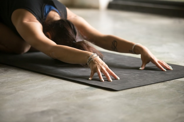 Close up of female hands, balasana pose