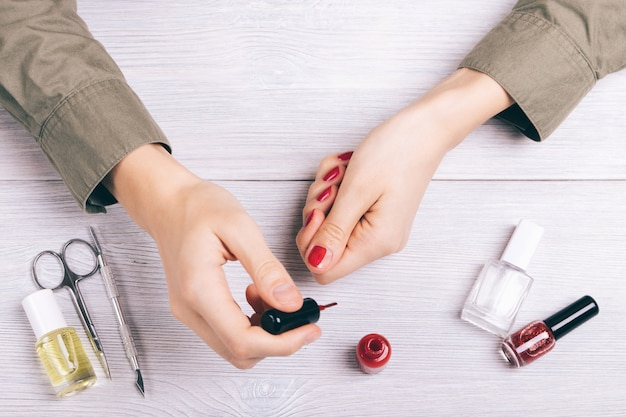 Close-up of female hands doing a manicure