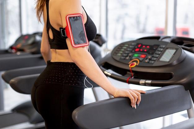 Close-up female training on treadmill