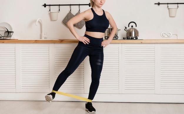 Close-up female training with elastic band