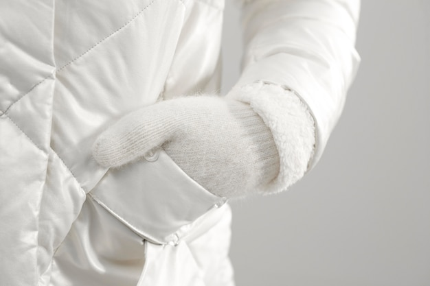 Close up female wearing gloves and holding hand in pocket