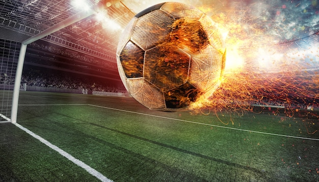 Close up of a fiery soccer ball kicked with power at the stadium scoring a goal