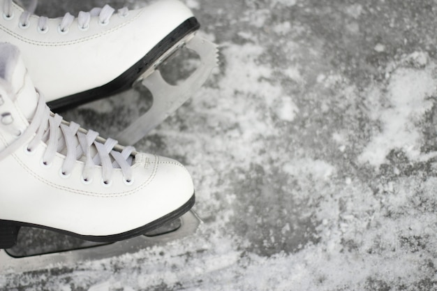 Close-up of figure skates. ice skating outdoor activities with the family in winter.