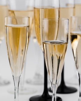 Close-up of filled champagne glasses