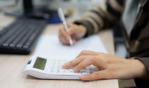 Close up on finger hand press on calculator for computing for working woman concept