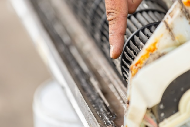 Close up of finger repairman point to dirty inside compartments air conditioner