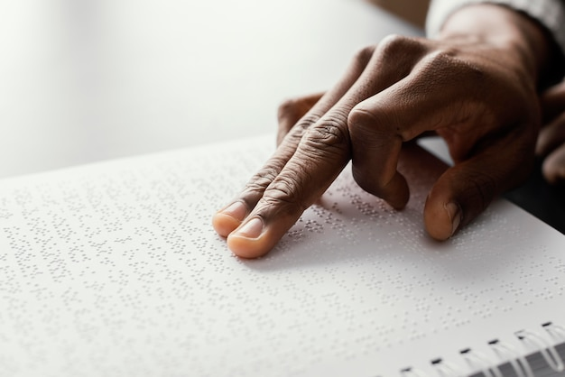 Close up fingers reading braille