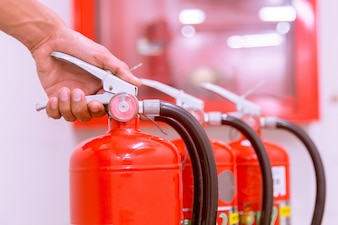 Close up Fire extinguisher and pulling pin on red tank.