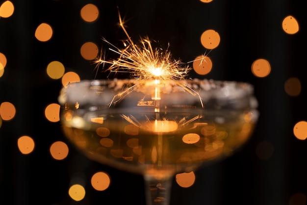 Close-up firework light reflected through glass