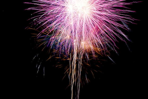 Close up the fireworks that rise from the ground to the sky and break out the colors.