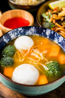 Close-up of fish balls and vegetables soup