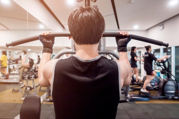 Close up fitness man exercise in the gym