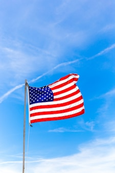 Close up flag of united states of america waving in the wind