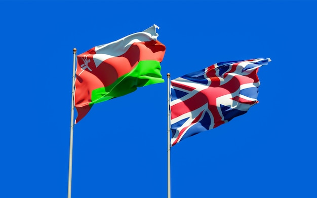 Close up on flags of oman and uk british