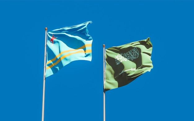 Close up on flags of saudi arabia and aruba