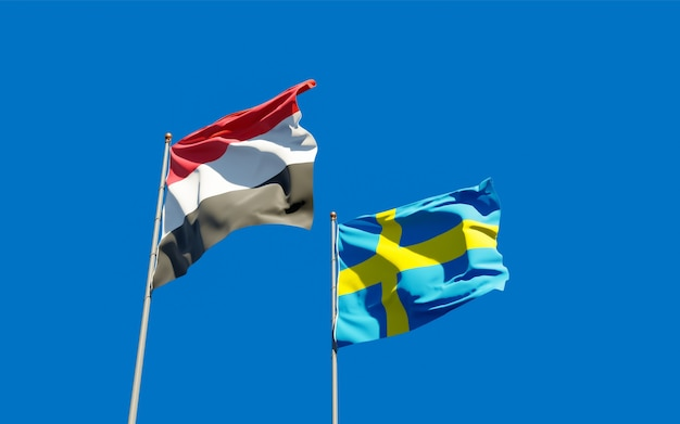 Close up on flags of yemen and sweden