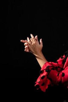 Close-up flamenca dancer clapping hands