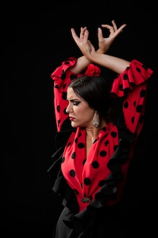 Close-up flamenca dancer raising hands
