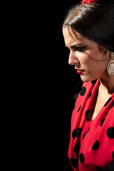 Close-up flamenca woman looking down