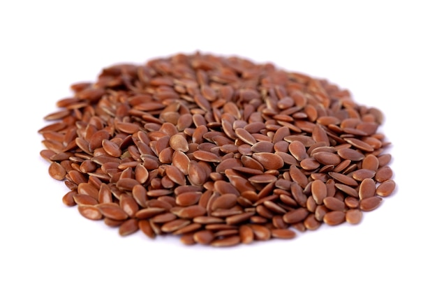 Close-up of flax seeds isolated on white background. food