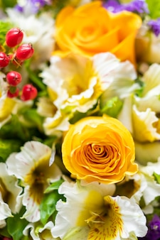 Close up of flower bouquet with yellow roses and white roses