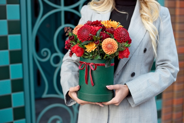 Close-up flower-box in woman hands as a gift concept for wedding