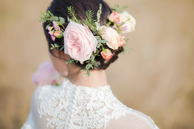 Close up of flowers on the bride's head