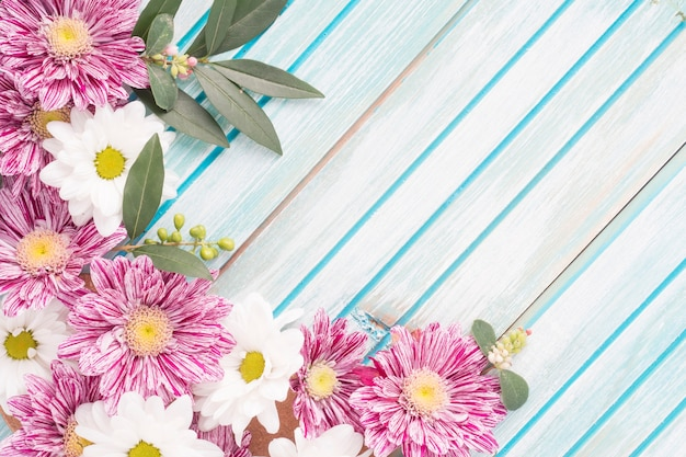 Close-up of flowers decoration on wooden striped backdrop