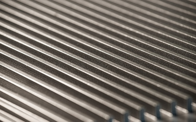 Close-up of a fluted metal surface next to a control panel on an unidentified automatic control device in a factory