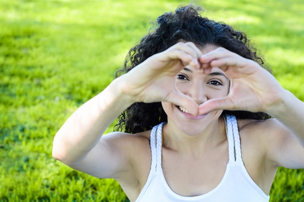Close up focus woman hands show love symbol.
