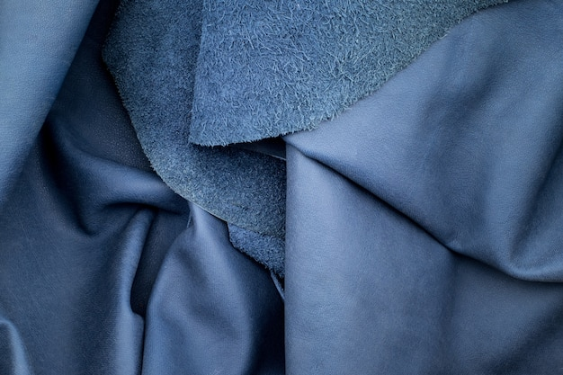 Close up fold navy blue leather texture background