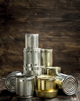 Close up on food in tin cans pile