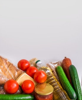 Close-up of food. vegetables, groceries, cheese and eggs on a white background