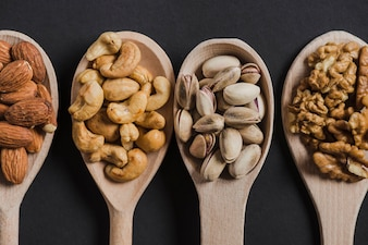 Close-up four spoons with nuts