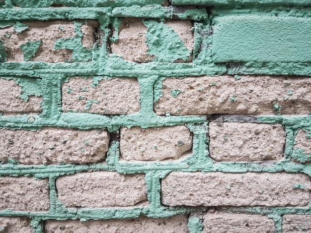 閉じる。古いレンガの壁の断片。背景とテクスチャ