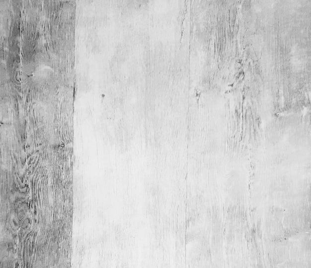 閉じる。白い不織布の壁紙の断片。背景とテクスチャ