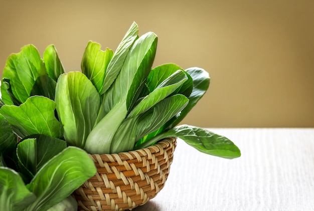 Close up the fresh baby green bok choy in basket