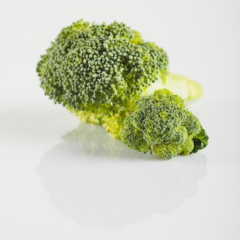 Close-up of fresh broccoli on white surface