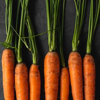 Close-up fresh carrots flat lay