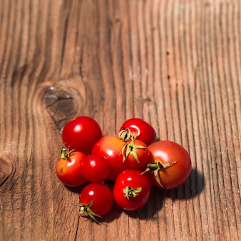 Close-up of fresh cherry tomatoes on wooden surface