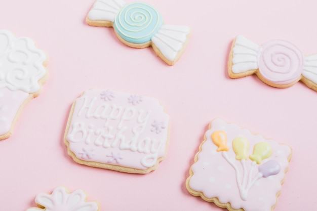 Close-up of fresh cookies on pink background