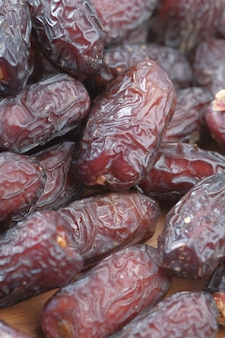 Close up of fresh date fruit in a bowl on table