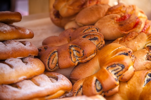 Close-up of fresh delicious buns with poppy seeds