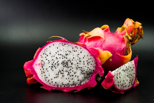 Close-up of fresh dragon fruits on black background