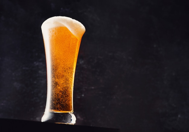 Close-up of a fresh glass of beer