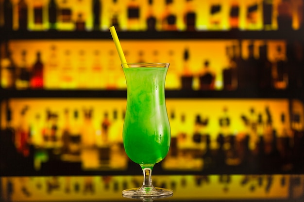 Close-up of a fresh green cocktail in elegant glass
